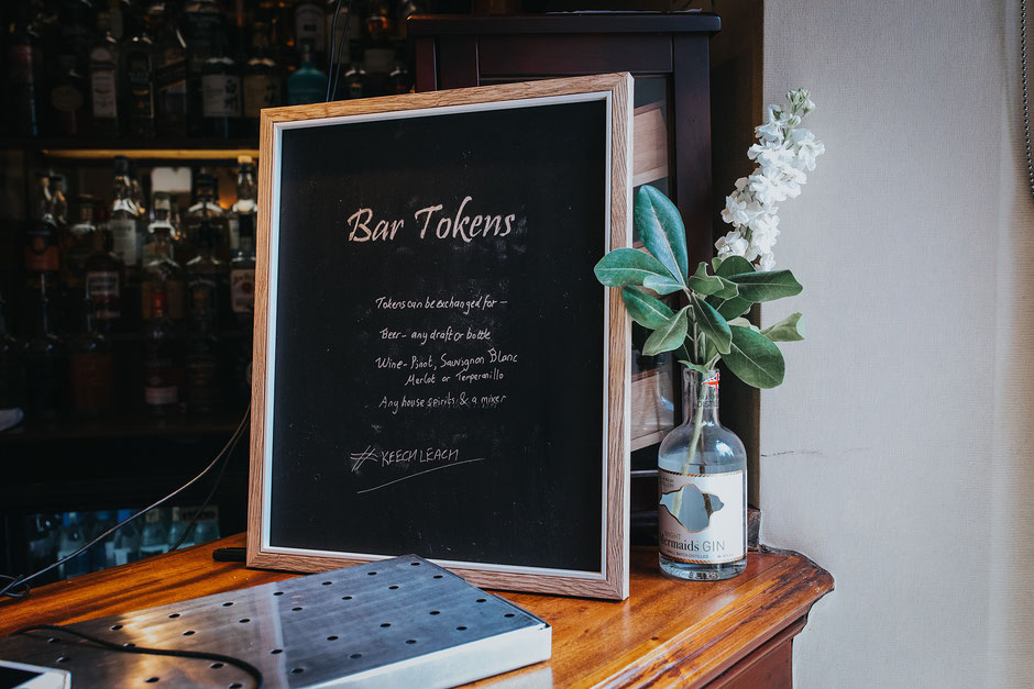a chalk board with details of how guests can use their free drinks tokens