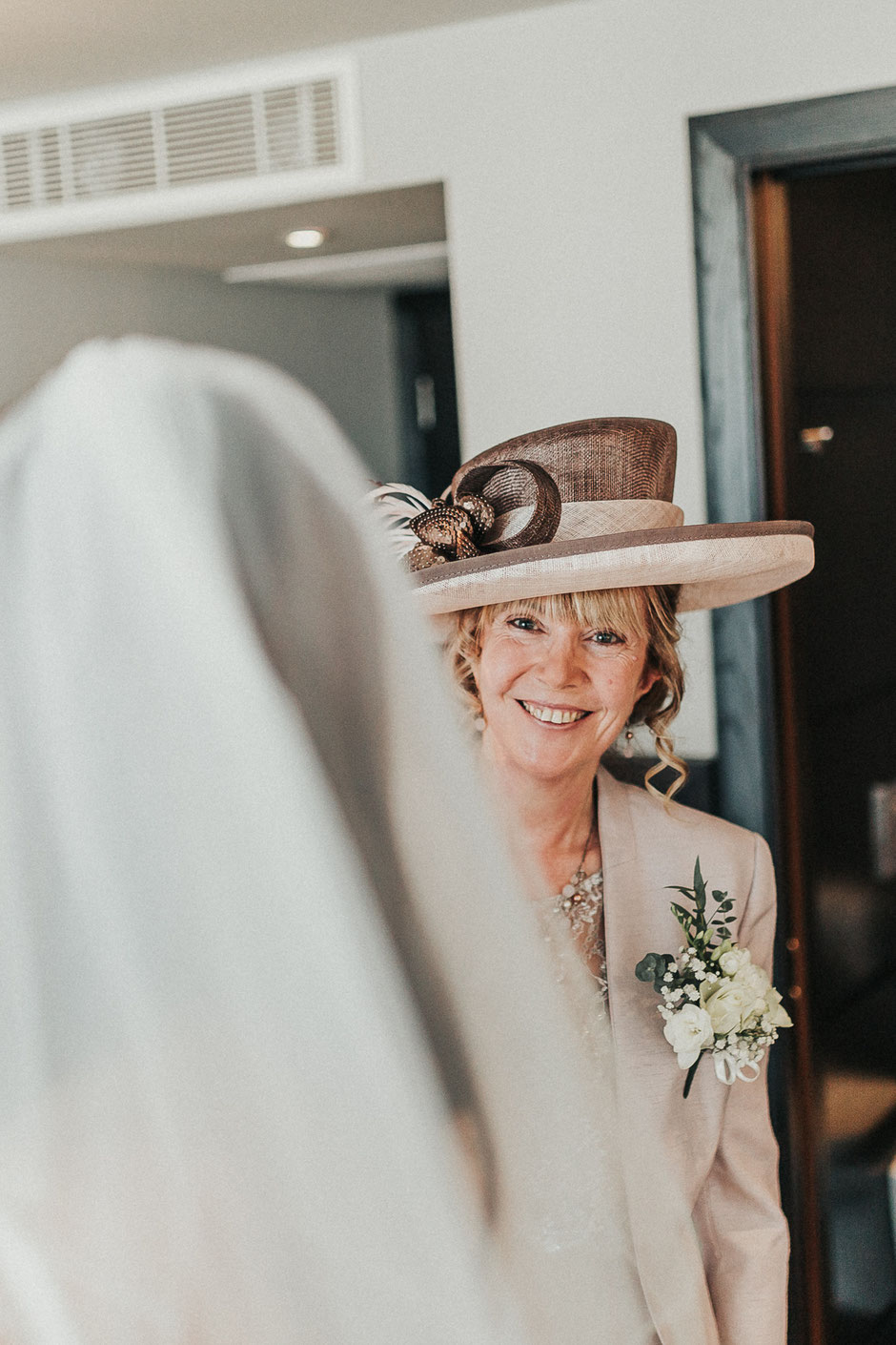 a portrait of the brides mother in a hat