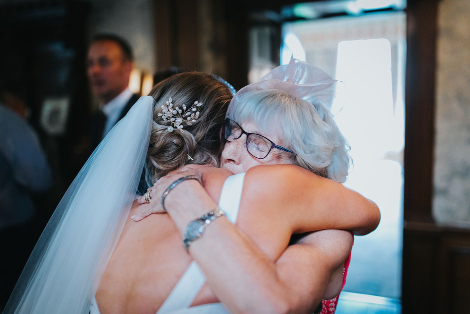 a bride and her grandmother hugging