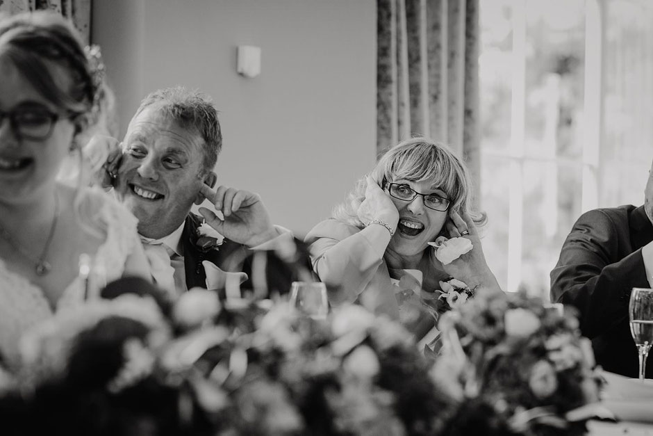 black and white photograph of a Mum & Dad during wedding speeches