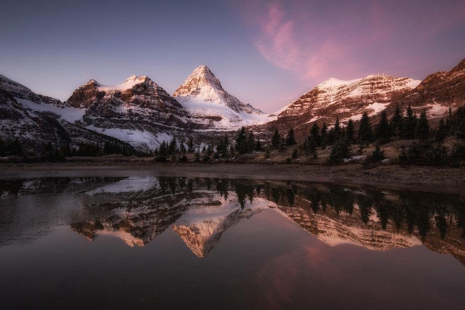 Mount Assiniboine reflecting in lake Magog
