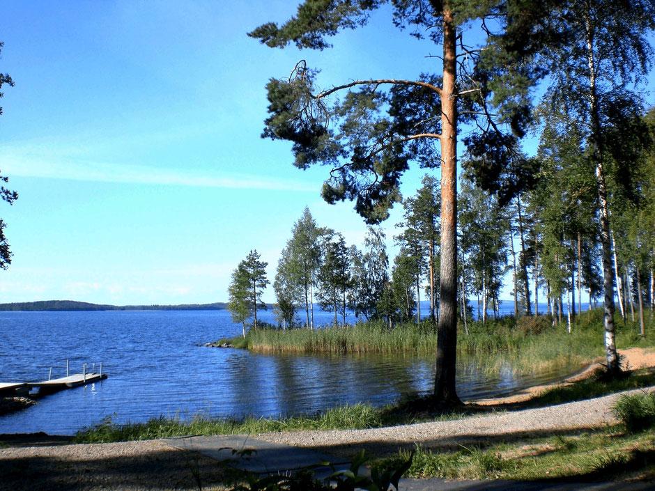 Sandstrand Badebucht Ferienhaus Finnland am See