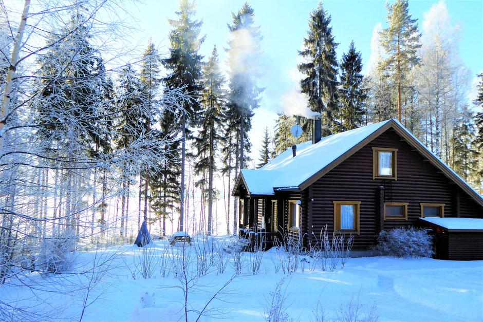 Gemütliches Ferienhaus Blockhaus am See Winter