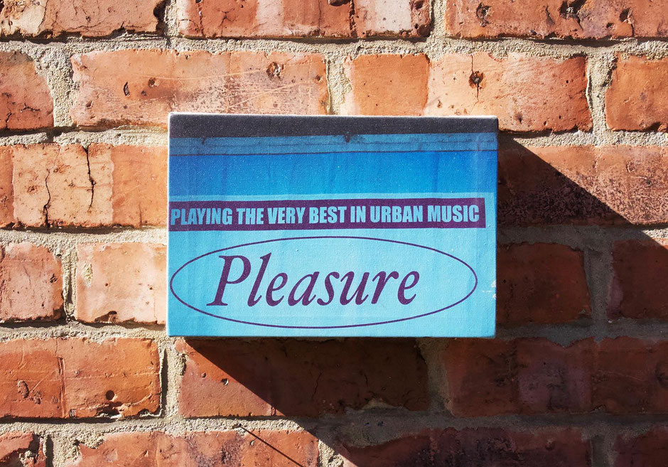 pleasure a feeling of hapiness satisfaction and enjoyment blue canvas wall decor manchester urban music scene wall print music lover