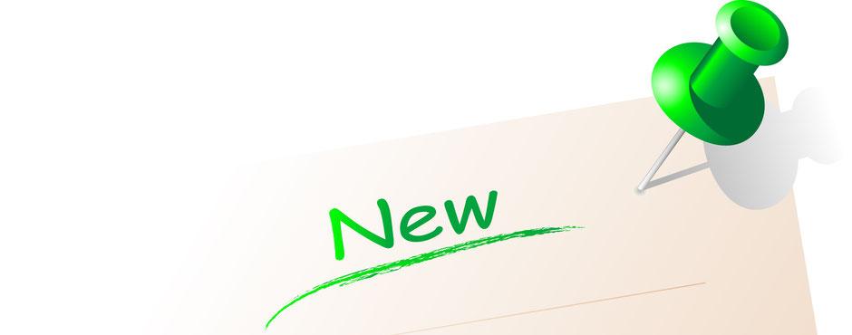 grüner Pin mit text  New unterstrichen in frischem Frühlingsgrün