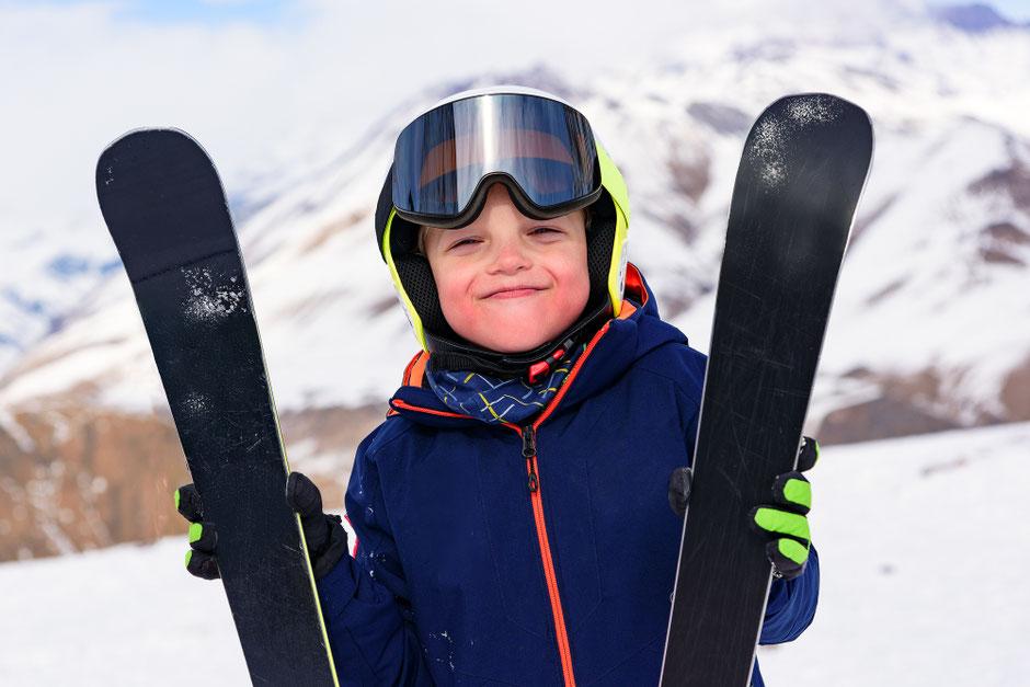 Skilift in Kitzbühel, Urlaub mit Kind, Skifahren mit Kindern