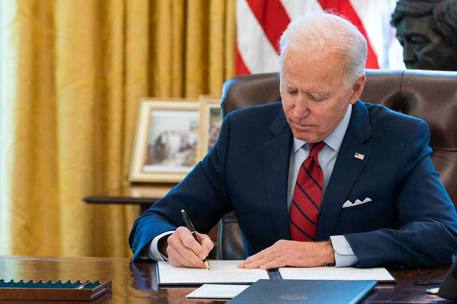 Joe Biden signs the American Rescue Plan (source whitehouse.gov)