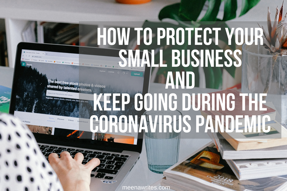 WOMAN TYPING ON LAPTOP AT HOME LOOKING AFTER BUSINESS DURING CORONAVIRUS PANDEMIC
