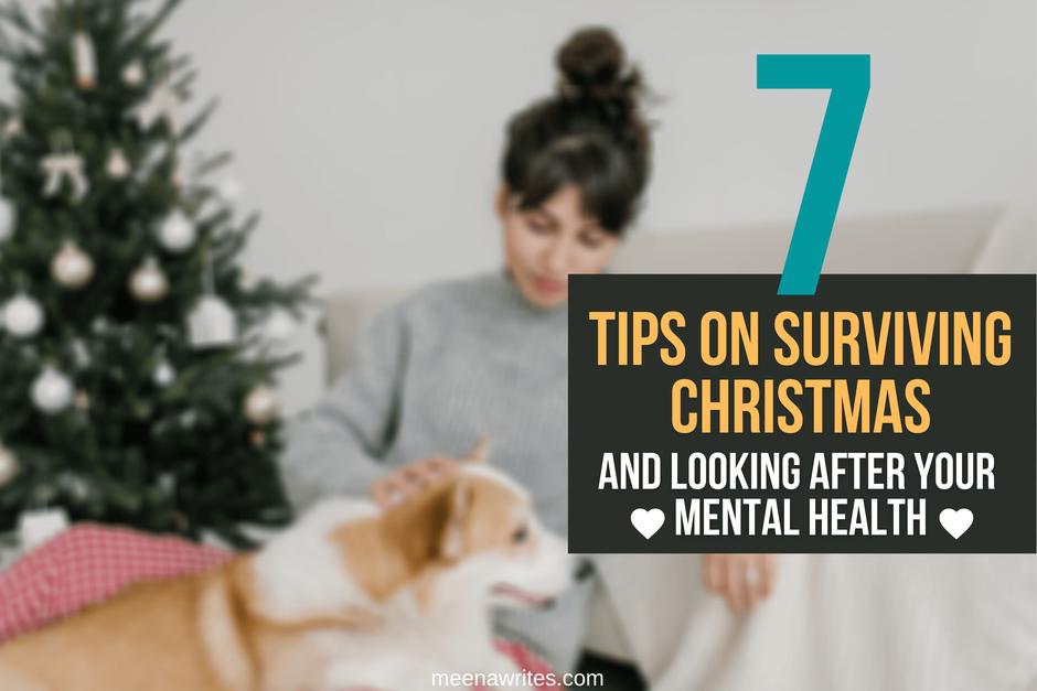 WOMAN PATTING DOG SITTING NEAR A CHRISTMAS TREE