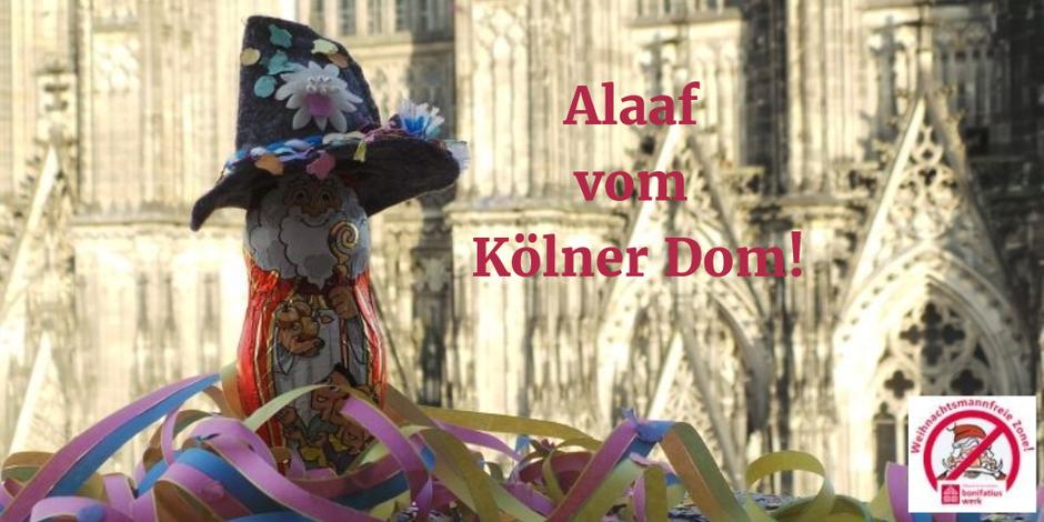 Mit Wanderhut, Konfetti und Luftschlangen verkleidet steht der Nikolaus vor dem Kölner Dom.