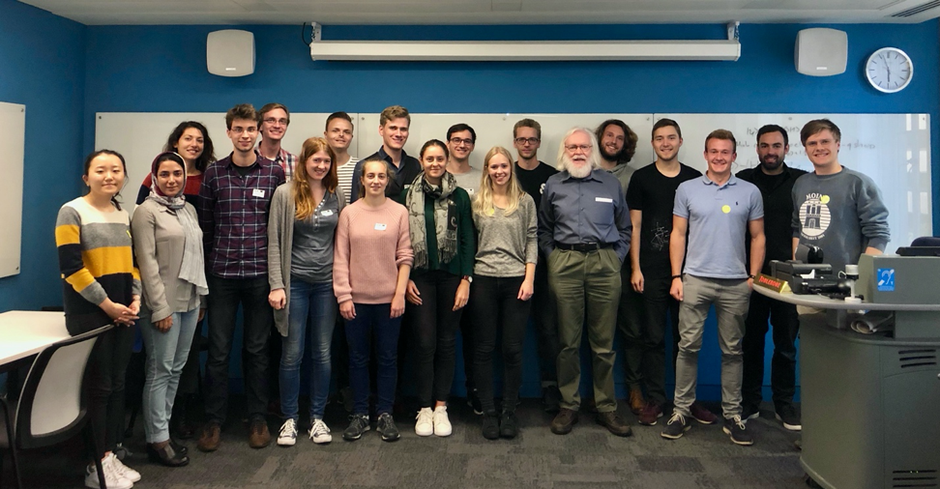 Group picture after Prof. John Elis' talk about gravitational waves and the role of Quantum Technologies in their discovery