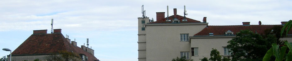 Mobile phone towers - cell phone towers and point-to-point radio antennas on the roofs of apartment buildings in Vienna, Austria.