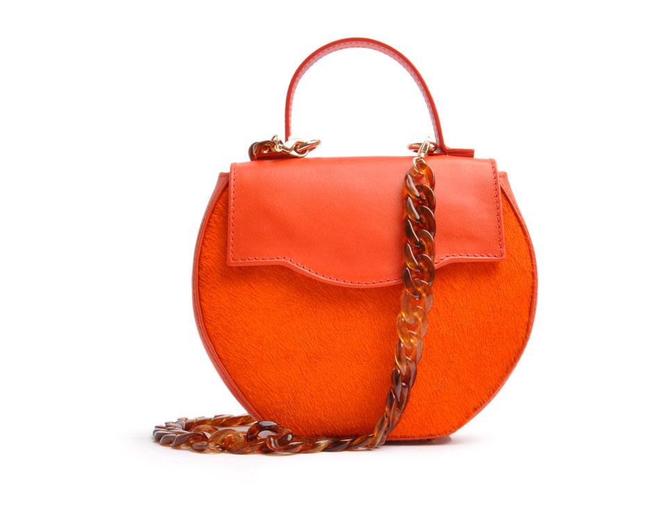 exklusive Dirndltasche in orange, aus echtem Leder mit modischer Acrylkette