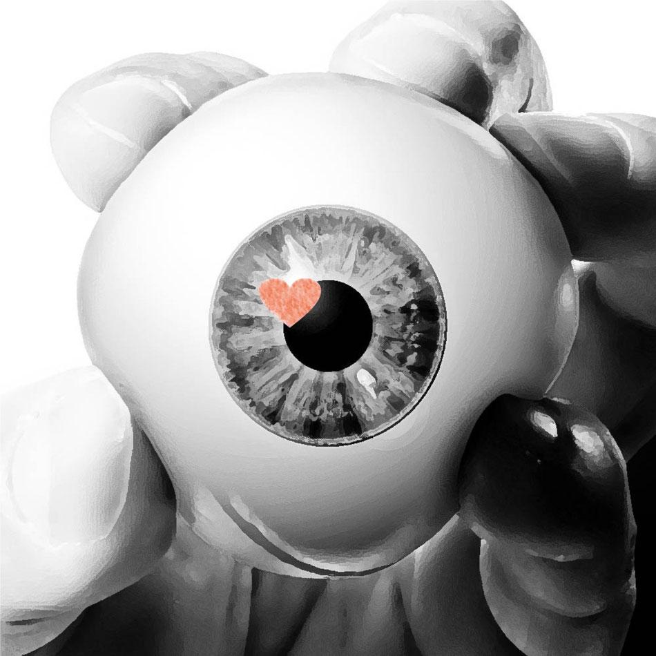 un ojo que ha sido extraído y sobre la mano palpita...