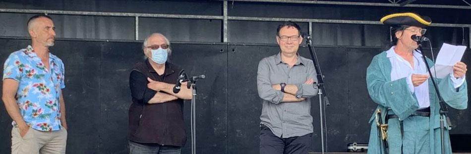 Hugues Mahoas, Jean-Yves Guillaume et Patrice Pellerin, Christophe Rivallain, de l'association BD-Photo     Ouest-France
