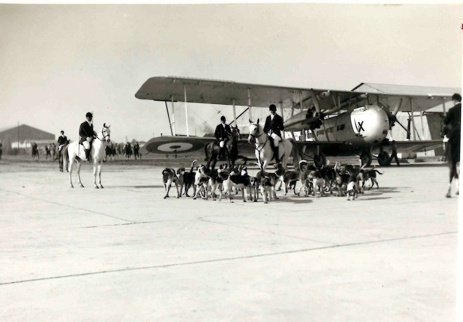 "The ""Royal Exodus"" Hunt at Hinaidi - FO Oliver on Left.  The aircraft is a Vickers from 70 Squadron.  Jackals were hunted in the desert..."