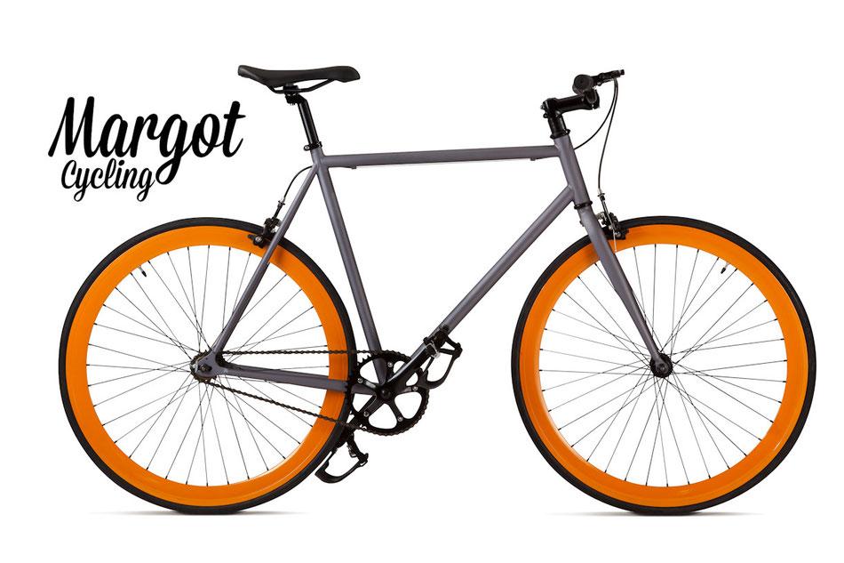 In foto, la fixed bike MARGOT LAMPO. Molto piacevole l'abbinamento grigio canna di fucile del telaio con i cerchi arancio da 43 mm.