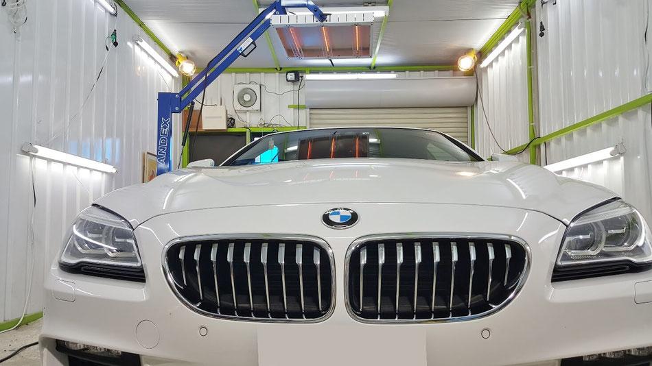 ソフトトップコーティング中のBMW6 埼玉の車磨き専門店