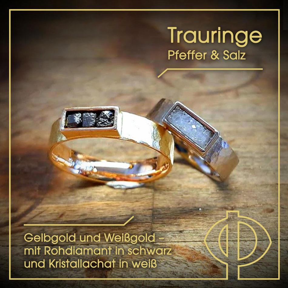 Handmade Trauringe aus Gelbgold und Weißgold; Rohdiamant in schwarz und Kristallachat in weiß – handgearbeitet in der Goldschmiede P. Oellerich in Bremerhaven