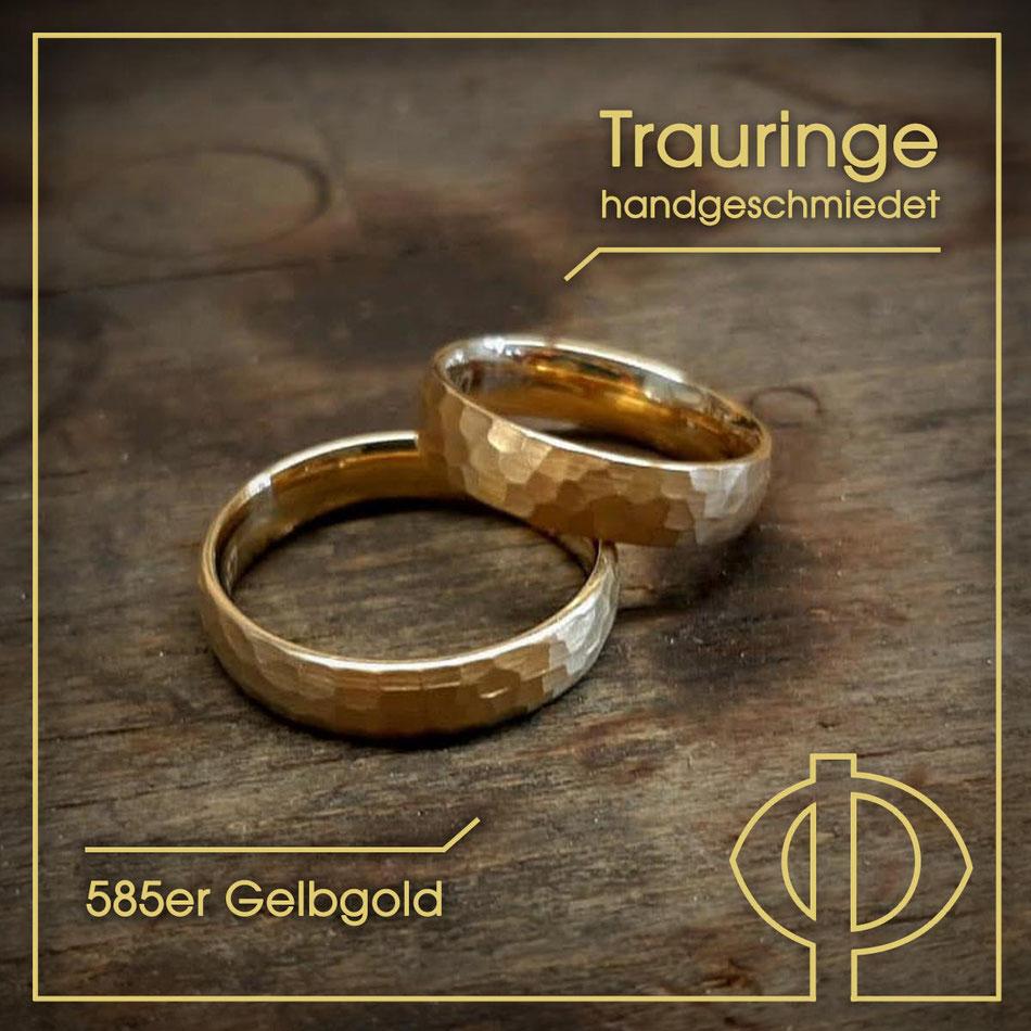 Geschmiedete Trauringe aus 585er Gelbgold – handgearbeitet in der Goldschmiede P. Oellerich in Bremerhaven