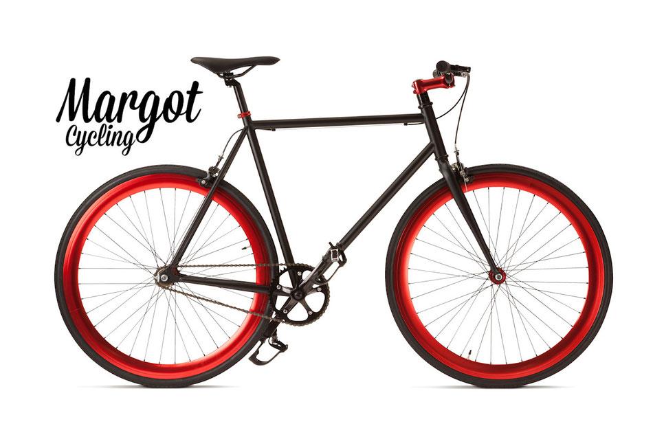 Fixed bike MARGOT TORO LOCO. Cuadro negro opáco y partes negras. Resalta el ROJO vivo anodizado de los aros, de la tija de manillar y de los bujes.