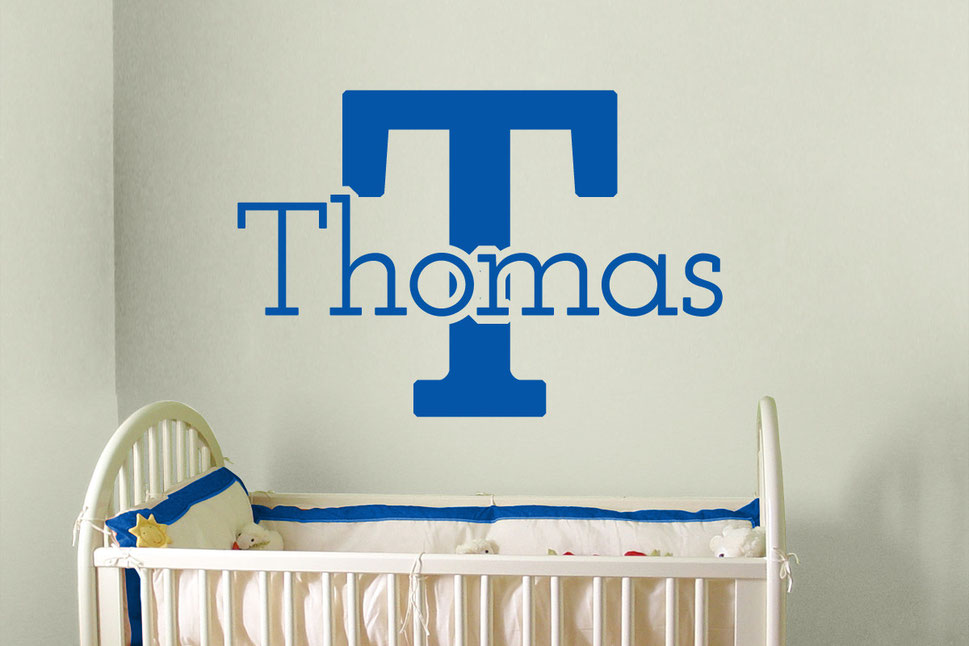 Thomas vinyl personalised wall art decal in a marine blue. Adding a cute touch to a dull room. Perfect for decorating a new born's bedroom having their name over the cot. From www.wallartcompany.co.uk
