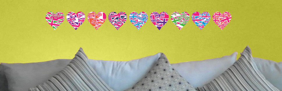 Mixed Magenta Pink Union Jack Uk heart stickers in a straight line pattern wall art from www.wallartcompany.co.uk