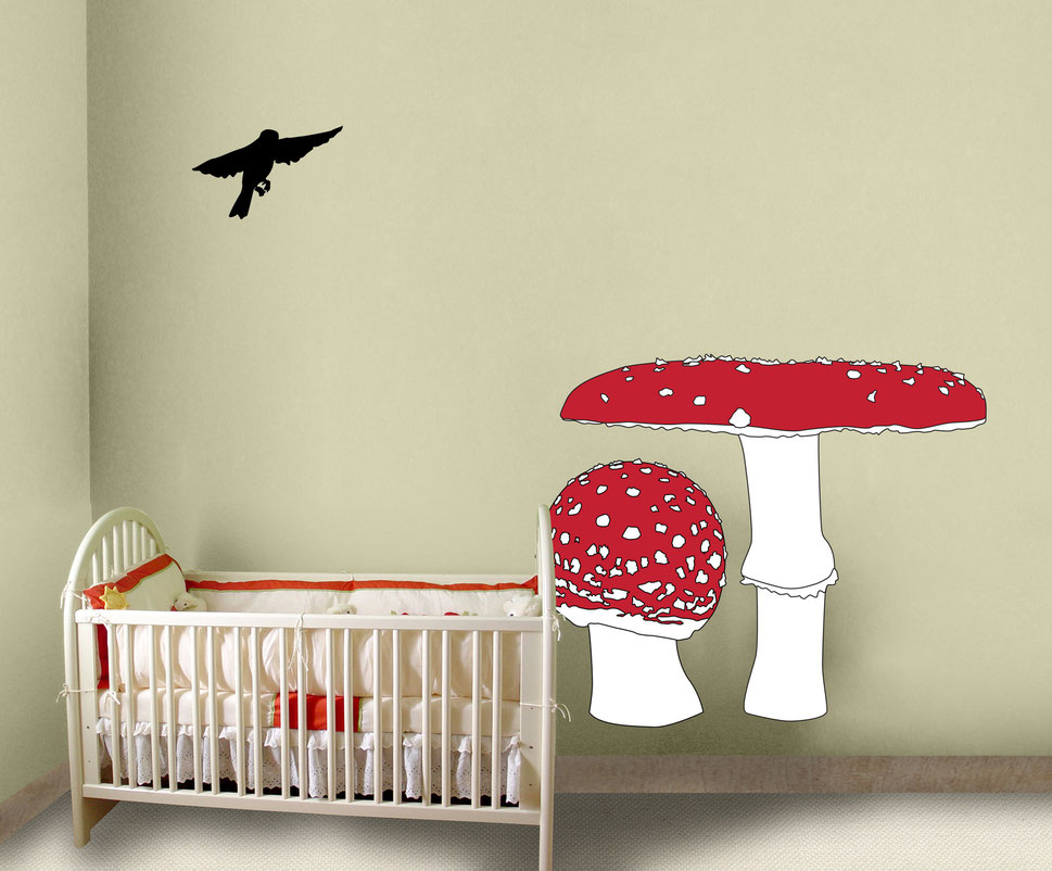 Vinyl wall art graphics that are printed and cut, using the colours red, white and black these mushrooms make a cute addition to any room. The room displaying the graphics is a cream colour in a nursery or children bedroom.