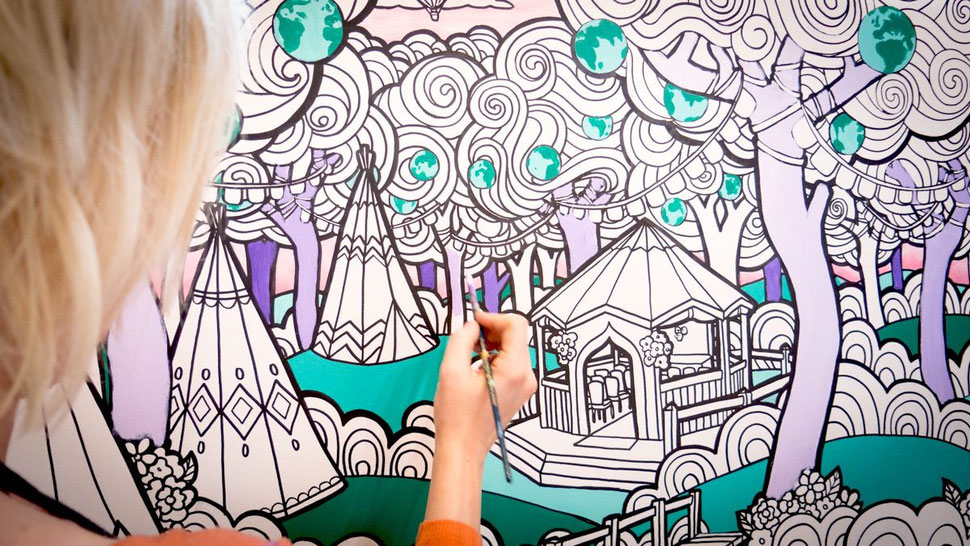 A hand illustrated giant colouring canvas gets painted in our studio