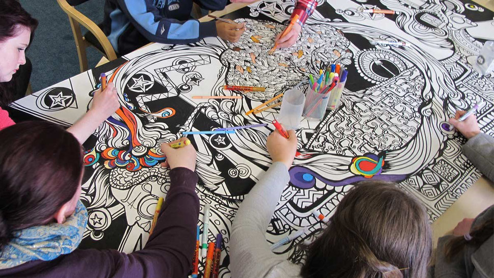 The young people from charity Action for Children colour their wall art