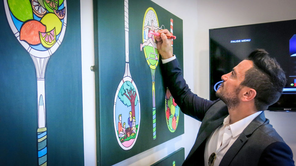 Peter Andre makes art at Wimbledon by colouring it in