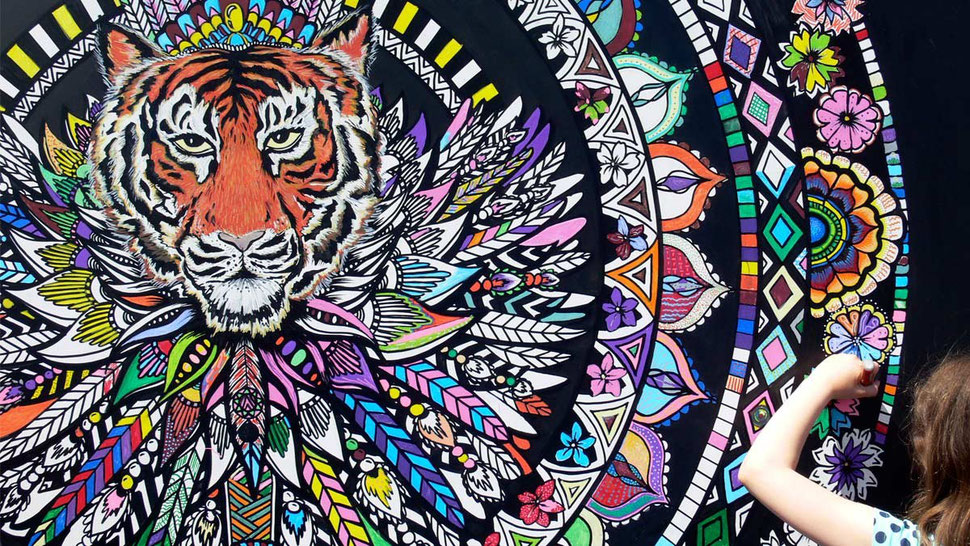 giant mandala gets coloured by the public