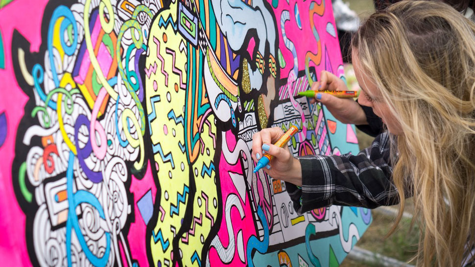 Giant wall art colouring in at a festival