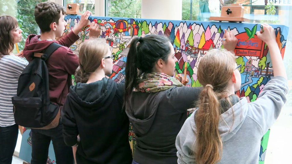 the public collaborate on a huge colouring canvas