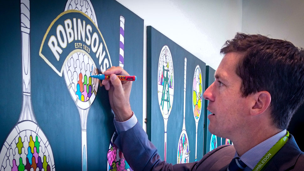 Tim Henman makes art by colouring it at Wimbledon