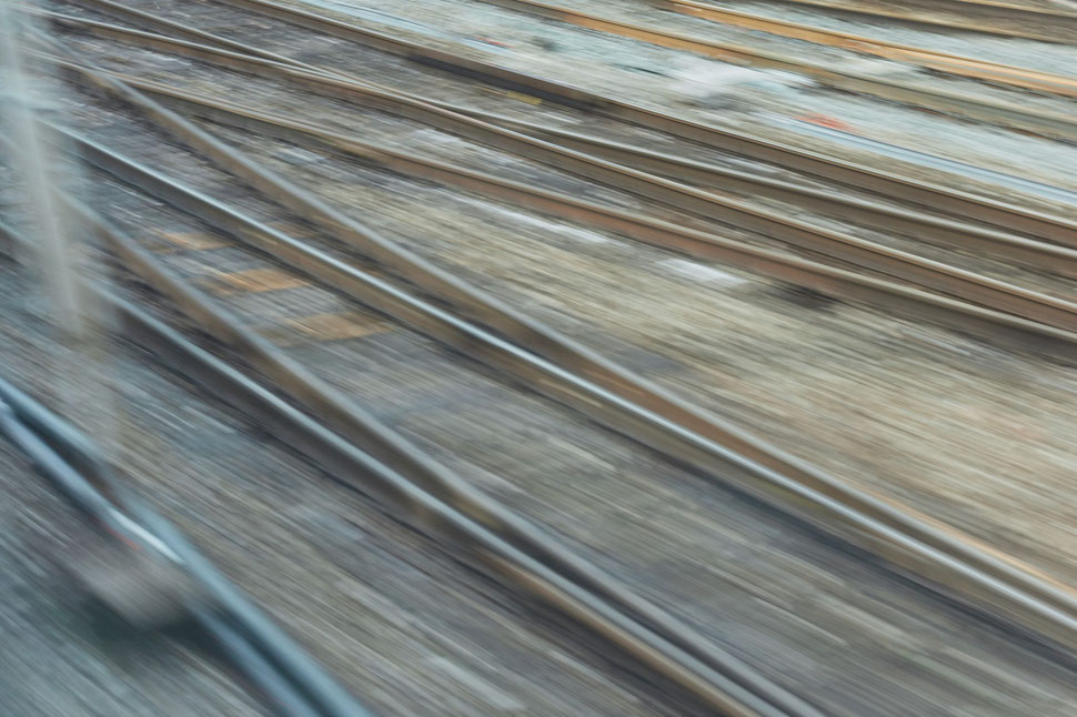 The image shows the photograph of several slightly blurred rail tracks.