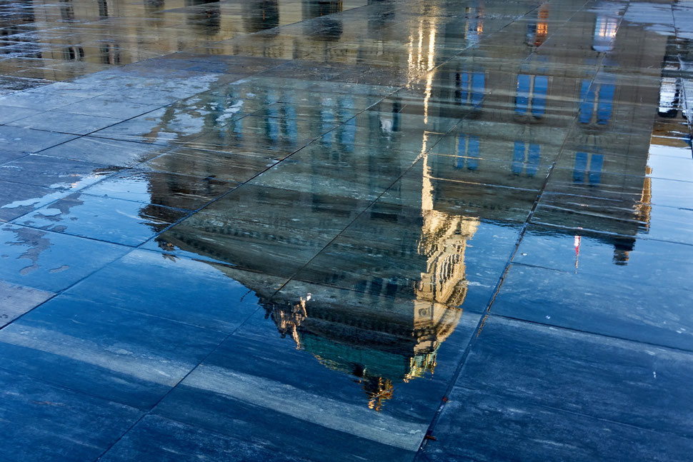 The photograph shows an image of a reflection of the federal palace in Bern, Capital of Switzerland.