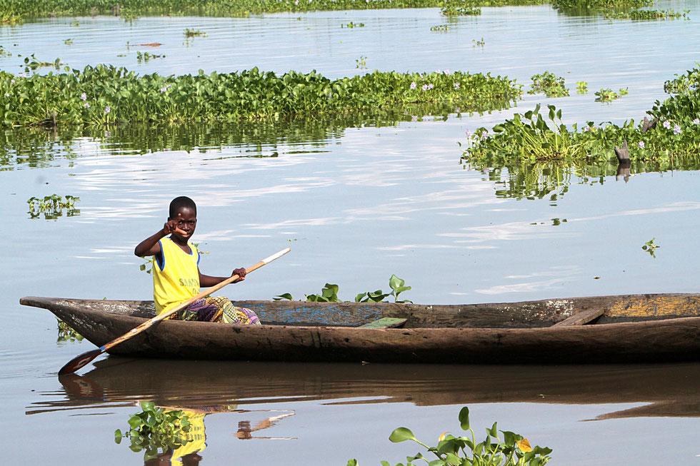 African children in a canoe. Lakeside town. Lake Nokoue. Ganvie.