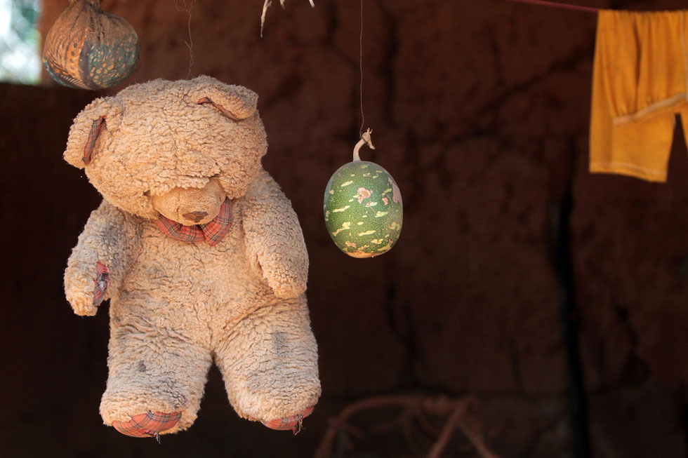 Teddy bear hanging from a window. Tori.