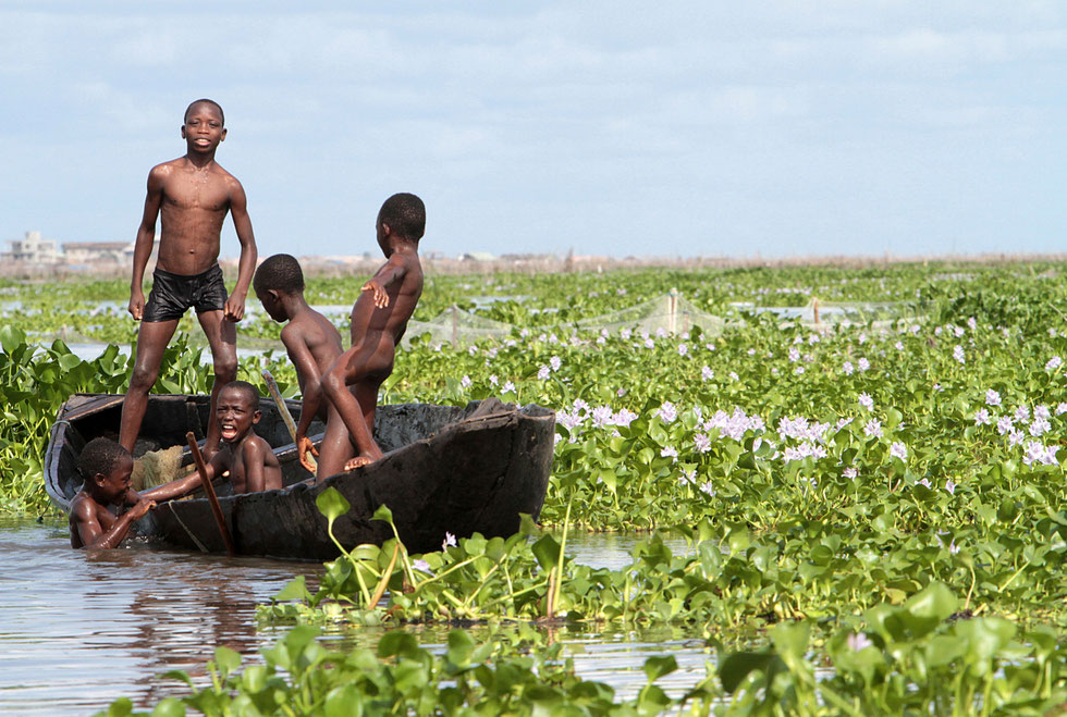 African children playing on a canoe. Lake Nokoue. Ganvie.