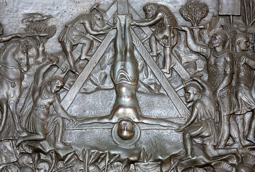 The Crucifixion of St. Peter. Detail of a portal. Front Entrance Door of St. Peter's Basilica. Roma.