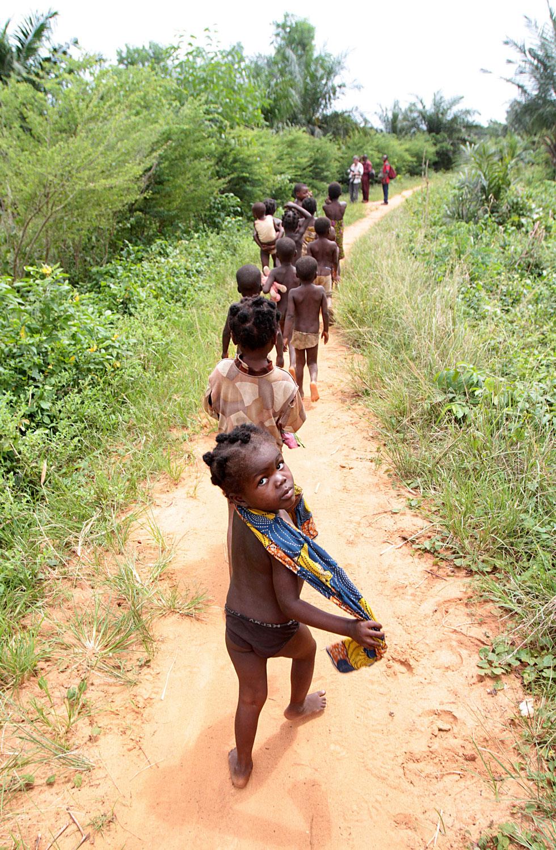 African children walking on a dirt road. Tori.