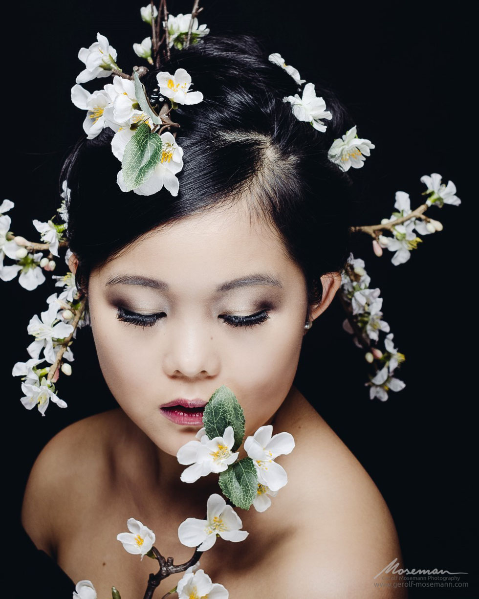 Girl with flowers in her hair.