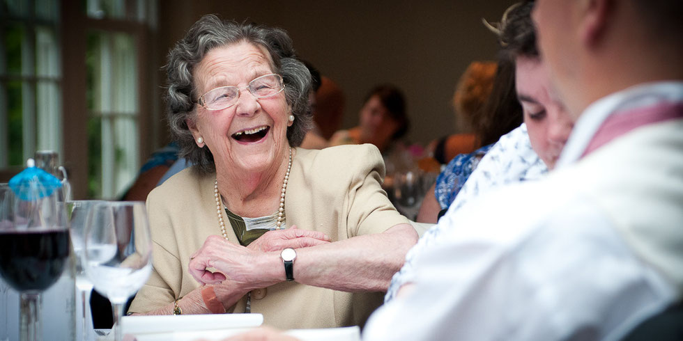 smiling guest during wedding day speeches hartnoll hotel tiverton