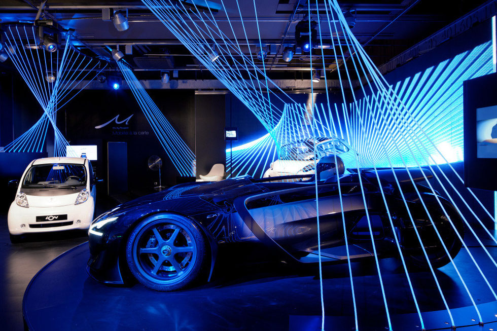design scénographie exposition showroom automobile technologie