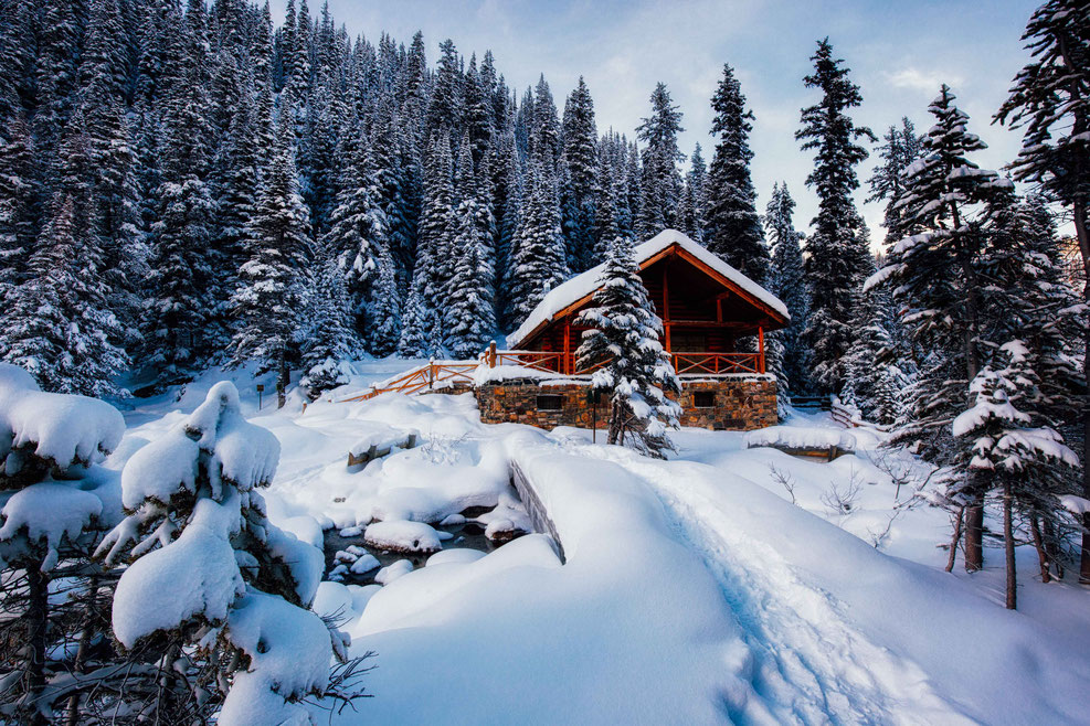 Lake Agnes Teahouse near Lake Louise covered under a think blanket of snow by InAFaraway_land
