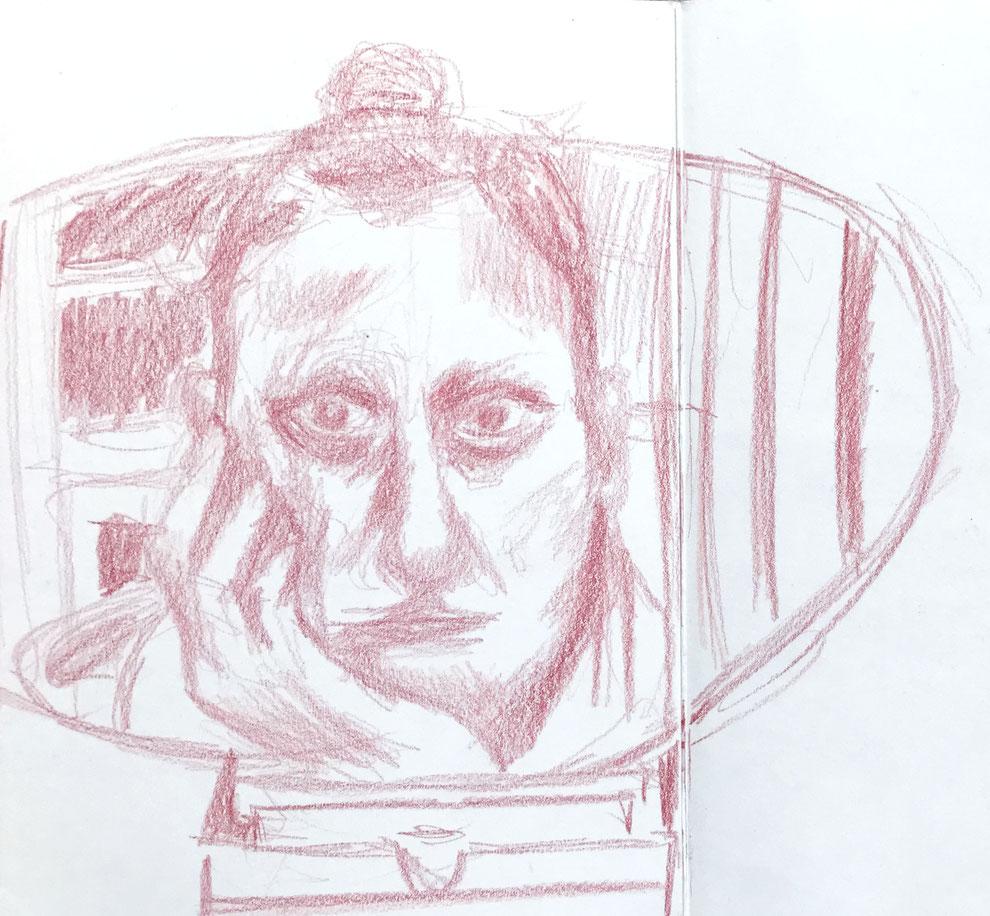 Zelfportret in rood potlood gemaakt in een schetsboek