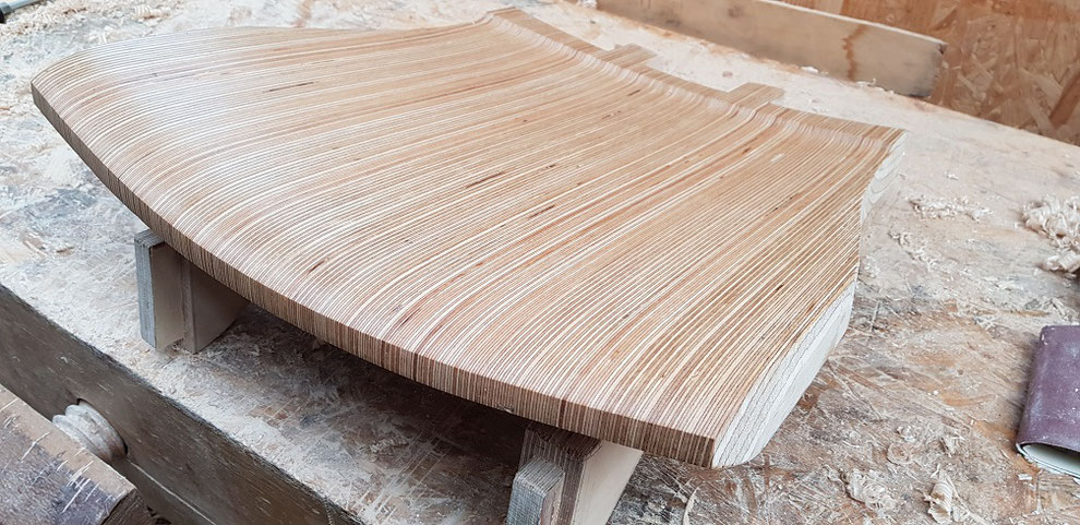 Laminated and carved rocking chair seat of birch ply wood. Build a wooden rocking chair.