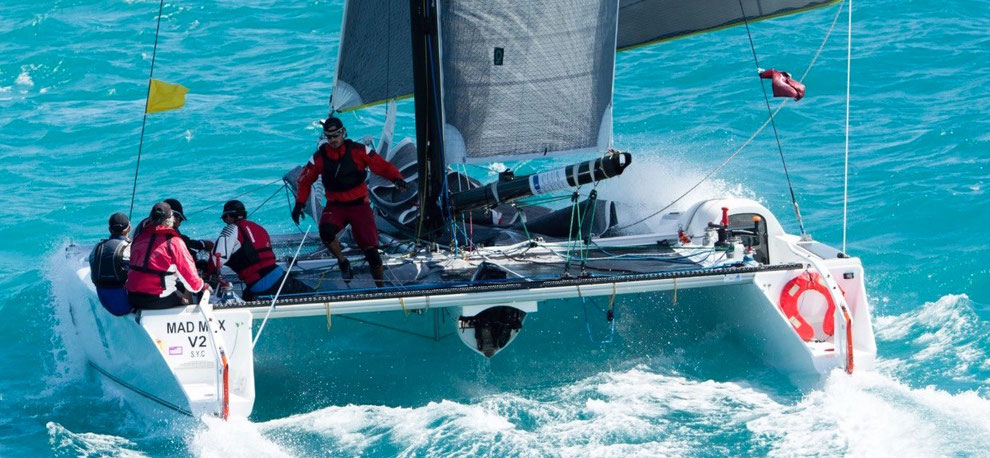 Crew action aboard Mad Max racing at Hamilton Island