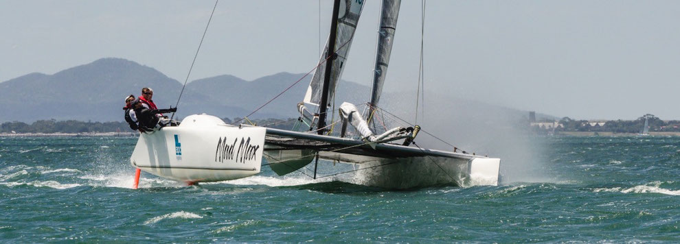 Catamaran Mad Max racing in fresh breeze